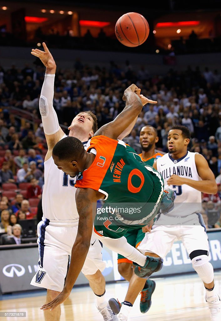 Ja'Quan Newton of the Miami Hurricanes fouls Ryan Arcidiacono of the Villanova Wildcats in the first half during the 2016 NCAA Men's Basketball...