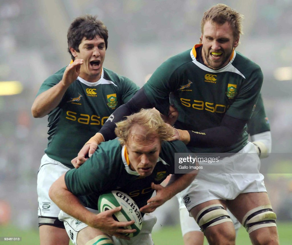 Jaque Fourie and Andries Bekker celebrate with Schalk Burger of South Africa after Burger scored a try during the the Guinness Series 2009...