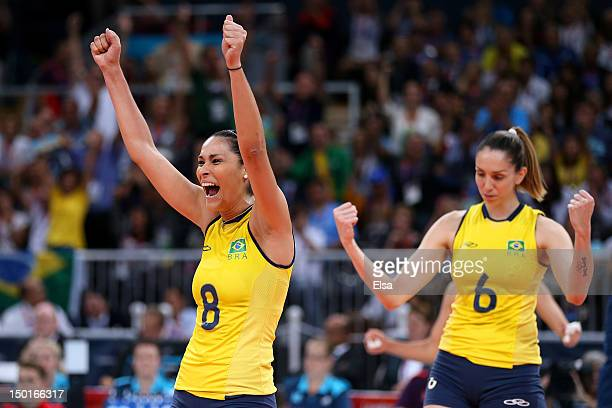 Jaqueline Carvalho Thaisa Menezes of Brazil reacts after defeating the United States to win the Women's Volleyball gold medal match on Day 15 of the...