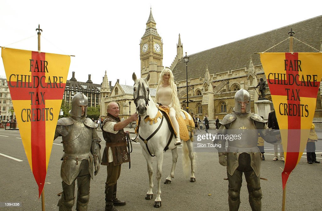 Jaqueline De Baer dressed as Lady Godiva rides in front of the Houses of Parliament at a protest demanding a 50 percent tax break for working...