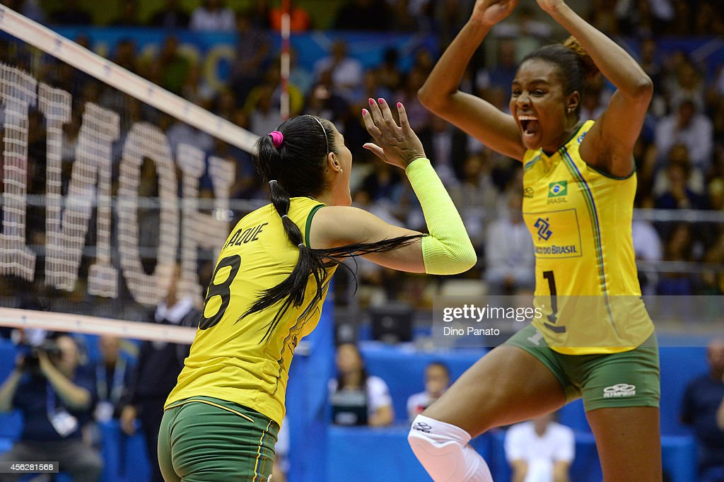 Jaqueline Pereira De Carvalho Endres and Fabiana Claudino of Brazil celebrate victory after the FIVB Women's World Championship pool Brankica Mihajlovic of Serbia B match between on September 28, 2014 in Trieste, Italy.