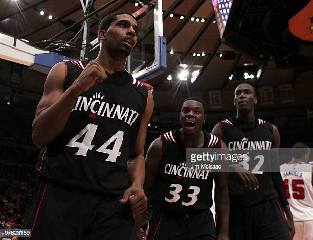 Jaquon Parker Lance Stephenson and Ibrahima Thomas of the Cincinnati Bearcats celebrates after a play in the second half against the Louisville...