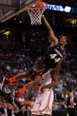 Jaquon Parker of the Cincinnati Bearcats gets fouled on his way to the basket by Deshaun Thomas of the Ohio State Buckeyes during their 2012 NCAA...