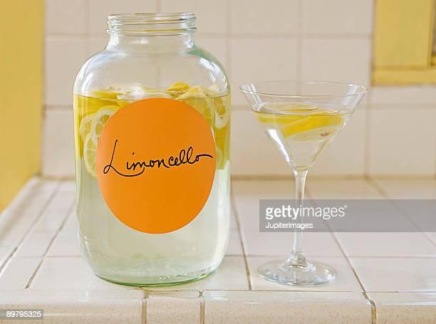 Jar and glass of limoncello