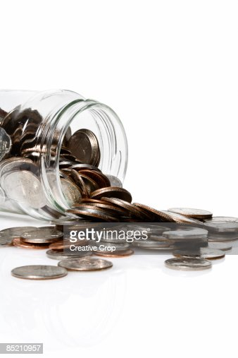 Jar full of coins : Stock Photo
