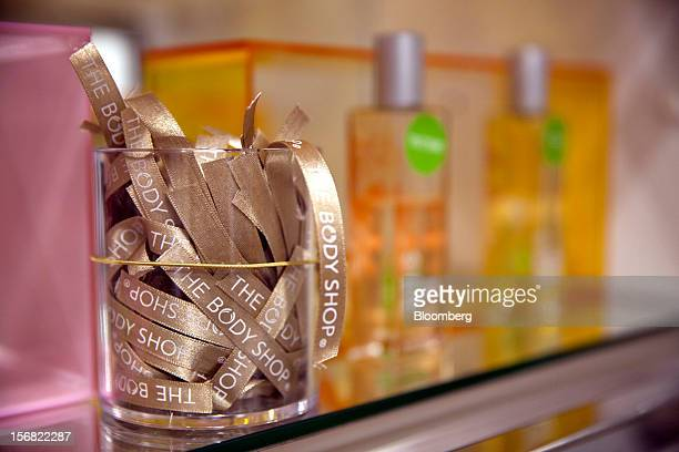 A jar of Body Shopbranded testers used for Parfum are seen on display at a store in Paris France on Wednesday Nov 21 2012 Body Shop International Plc...