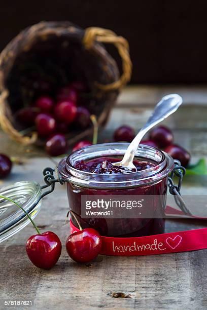 Jar of cherry jam and cherries, ribbon, handmade