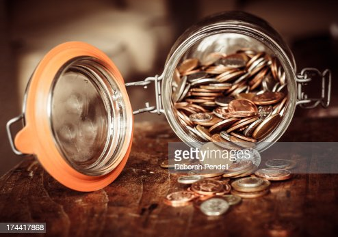 Jar of coins : Stock Photo