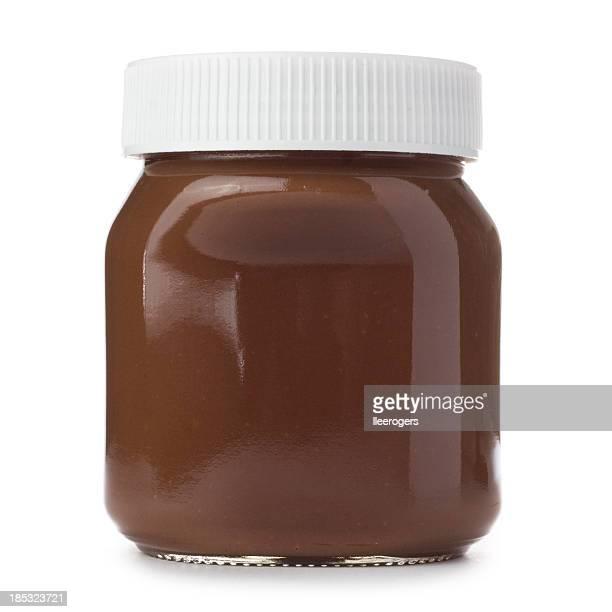Jar of hazelnut spread on a white background