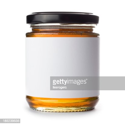 Jar of honey with blank label on a white background