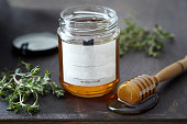 Jar of honey with herbs