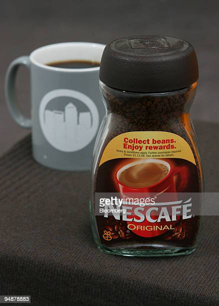 A jar of Nestle Nescafe is displayed in London UK on Thursday March 13 2008 Nestle SA the world's largest food company will probably report an...