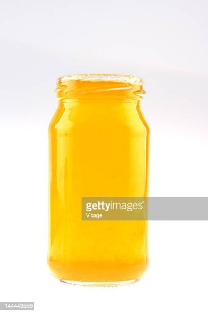A jar of orange marmalade without a lid