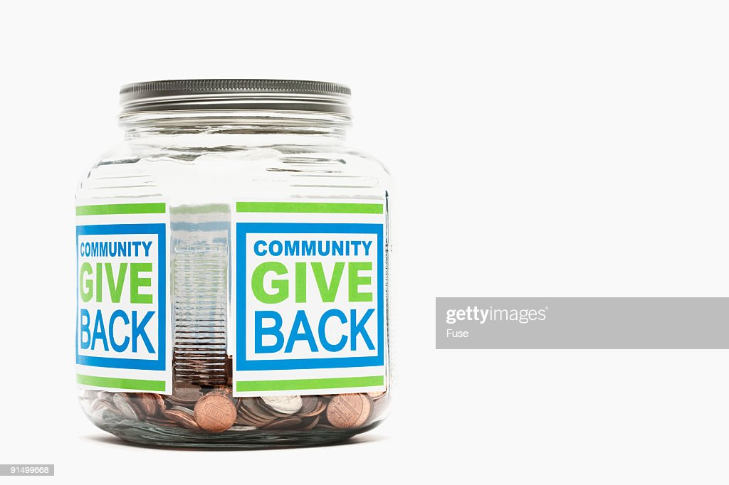 Jar of pennies with 'community give back' sticker