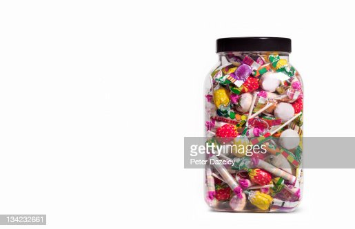Jar of sweets on white background