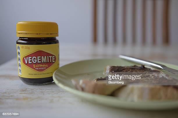 A jar of Vegemite spread stands next to a slice of toast in an arranged photograph in Melbourne Australia on Thursday Jan 19 2017 Bega Cheese Ltd who...