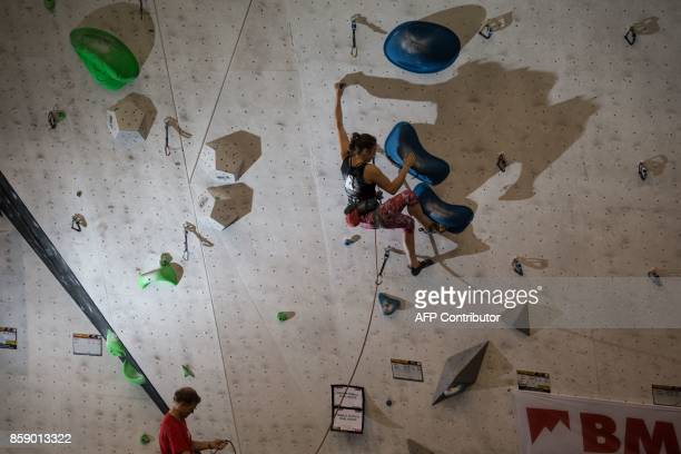 Jara Spate competes in the Female Senior category of the British Lead Climbing Championships at the Awesome Walls climbing centre in Sheffield...