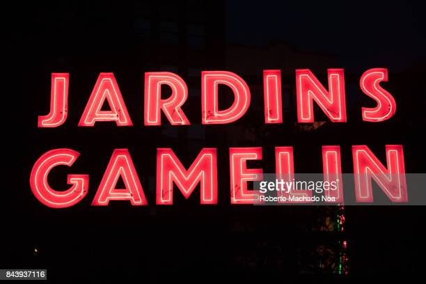 Jardins Gamelin red signage over a black background The park offers weeklong social events