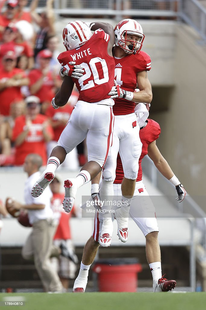 Jared Abbrederis #4 of the Wisconsin Badgers celebrates with James White #20 after making a touchdown during the game against the UMass Minutemen at Camp Randall Stadium on August 31, 2013 in Madison, Wisconsin.