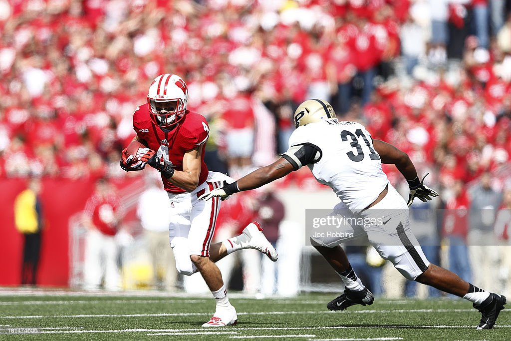 Jared Abbrederis #4 of the Wisconsin Badgers runs with the ball on a reverse play against the Purdue Boilermakers during the game at Camp Randall Stadium on September 21, 2013 in Madison, Wisconsin.