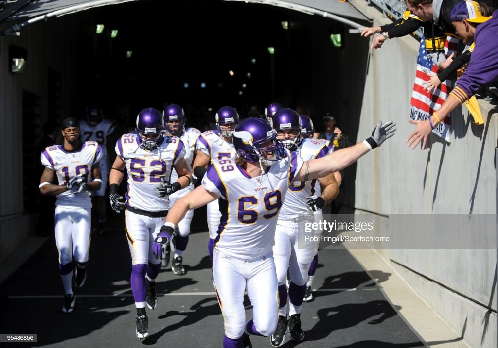 Jared Allen #69 and Minnesota Vikings walk through the tunnel for introductions before the game against the Pittsburgh Steelers at Heinz Field on October 25, 2009 in Pittsburgh, Pennsylvania. The Steelers defeated the Vikings 27-17.