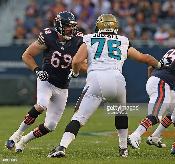 Jared Allen of the Chicago Bears rushes against Luke Joeckel of the Jacksonville Jaguars during a preseason game at Soldier Field on August 14 2014...