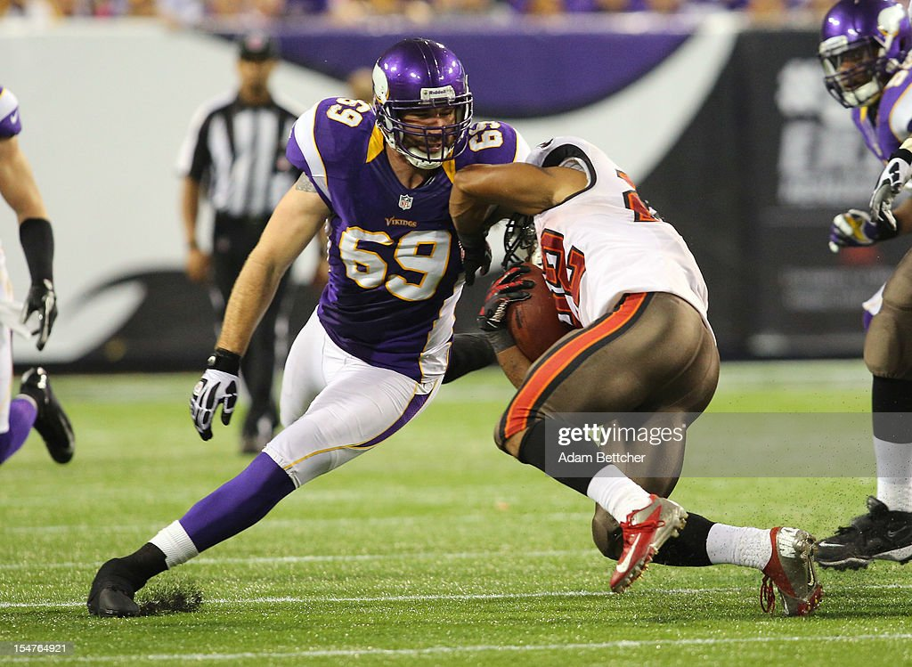 Jared Allen #69 of the Minnesota Vikings attempts the tackle on Doug Martin #22 of the Tampa Bay Buccaneers at the Hubert H. Humphrey Metrodome on October 25, 2012 in Minneapolis, Minnesota.