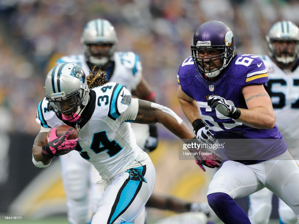 <a gi-track='captionPersonalityLinkClicked' href=/galleries/search?phrase=Jared+Allen&family=editorial&specificpeople=239098 ng-click='$event.stopPropagation()'>Jared Allen</a> #69 of the Minnesota Vikings gives chase to <a gi-track='captionPersonalityLinkClicked' href=/galleries/search?phrase=DeAngelo+Williams&family=editorial&specificpeople=618130 ng-click='$event.stopPropagation()'>DeAngelo Williams</a> #34 of the Carolina Panthers during the first quarter of the game on October 13, 2013 at Mall of America Field at the Hubert H. Humphrey Metrodome in Minneapolis, Minnesota. The Panthers defeated the Vikings 35-10.