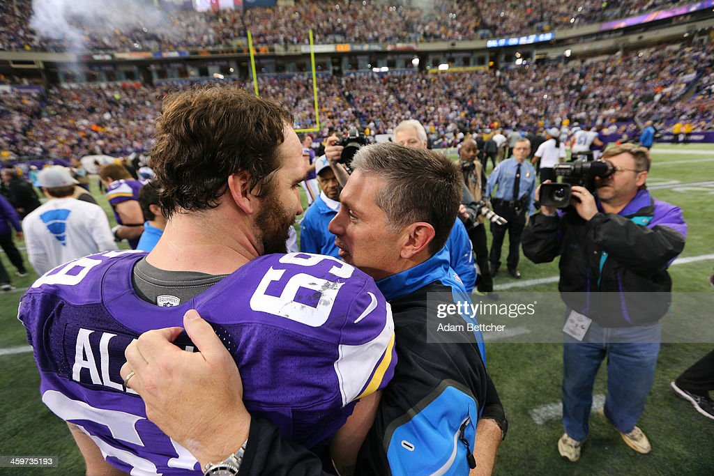 Jared Allen #69 of the Minnesota Vikings greets head coach Jim Schwartz of the Detroit Lions on December 29, 2013 at Mall of America Field at the Hubert H. Humphrey Metrodome in Minneapolis, Minnesota.