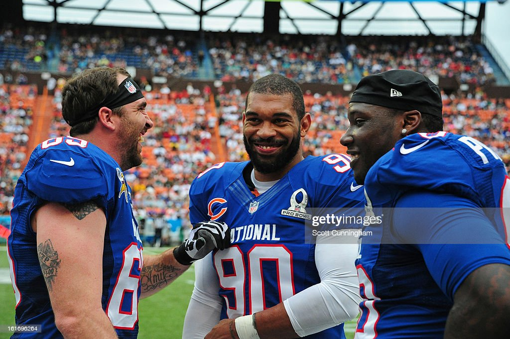 Jared Allen #69 of the Minnesota Vikings, Julius Peppers #90 of the Chicago Bears, and Jason Pierre-Paul #90 of the New York Giants and the NFC relax on the sidelines during the 2013 Pro Bowl against the American Football Conference team at Aloha Stadium on January 27, 2013 in Honolulu, Hawaii