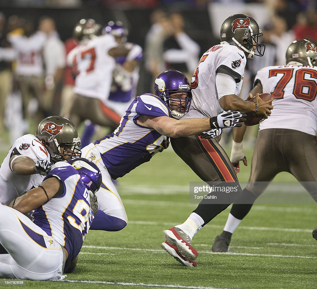 Jared Allen #69 of the Minnesota Vikings sacks Josh Freeman #5 of the Tampa Bay Buccaneers during an NFL game against the Tampa Bay Buccaneers at Mall of America Field at the Hubert H. Humphrey Metrodome on October 25, 2012 in Minneapolis, Minnesota.