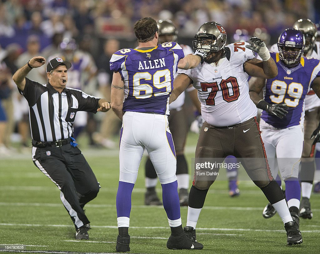 Jared Allen #69 of the Minnesota Vikings scuffles with Donald Penn #70 of the Tampa Bay Buccaneers during an NFL game against the Tampa Bay Buccaneers at Mall of America Field at the Hubert H. Humphrey Metrodome on October 25, 2012 in Minneapolis, Minnesota.