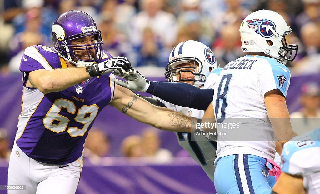 Jared Allen #69 of the Minnesota Vikings tries to get a hand on Matt Hasselbeck #8 of the Tennessee Titans at the Hubert H. Humphrey Metrodome on October 7, 2012 in Minneapolis, Minnesota.