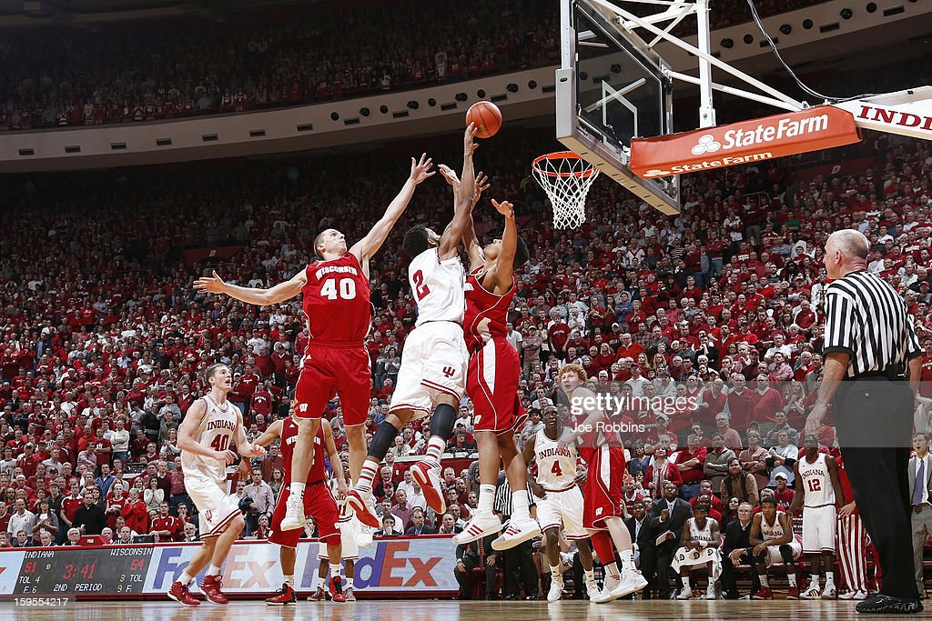Jared Berggren #40 and Ryan Evans #5 of the Wisconsin Badgers defend a shot against Christian Watford #2 of the Indiana Hoosiers during the game at Assembly Hall on January 15, 2013 in Bloomington, Indiana. Wisconsin defeated Indiana 64-59.