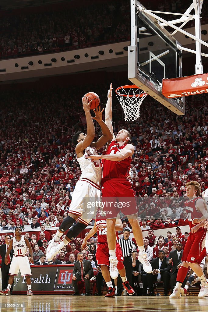 Jared Berggren #40 of the Wisconsin Badgers defends a shot against Christian Watford #2 of the Indiana Hoosiers during the game at Assembly Hall on January 15, 2013 in Bloomington, Indiana. Wisconsin defeated Indiana 64-59.