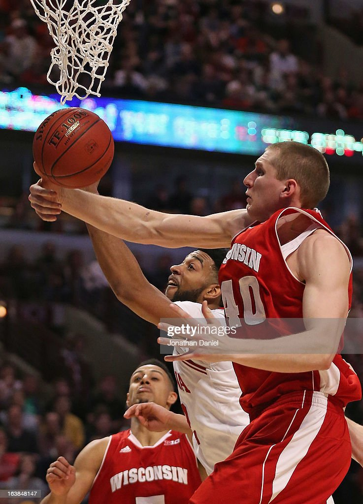 Jared Berggren #40 of the Wisconsin Badgers fights for a rebound with Christian Watford #2 of the Indiana Hoosiers during a semifinal game of the Big Ten Basketball Tournament at the United Center on March 16, 2013 in Chicago, Illinois.