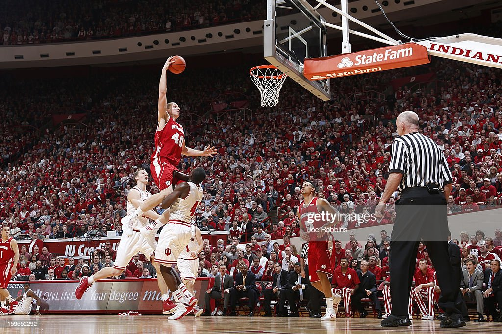Jared Berggren #40 of the Wisconsin Badgers goes up for a dunk against <a gi-track='captionPersonalityLinkClicked' href=/galleries/search?phrase=Victor+Oladipo&family=editorial&specificpeople=6681560 ng-click='$event.stopPropagation()'>Victor Oladipo</a> #4 of the Indiana Hoosiers during the game at Assembly Hall on January 15, 2013 in Bloomington, Indiana.