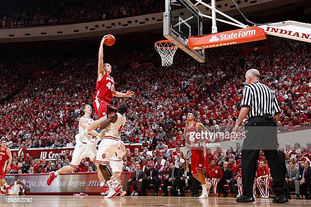 Jared Berggren of the Wisconsin Badgers goes up for a dunk against Victor Oladipo of the Indiana Hoosiers during the game at Assembly Hall on January...