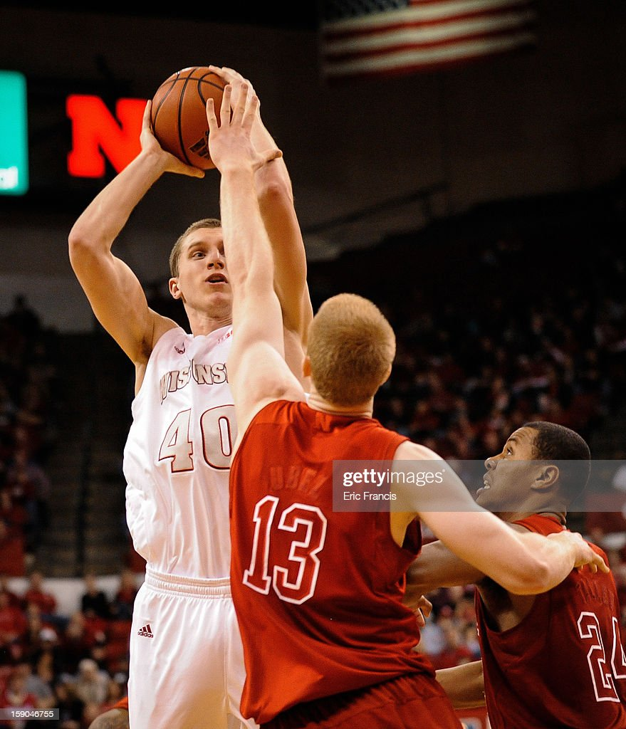 Jared Berggren #40 of the Wisconsin Badgers shoots over Brandon Ubel #13 of the Nebraska Cornhuskers during their game at the Devaney Center on January 6, 2013 in Lincoln, Nebraska. Wisconsin defeated Nebraska 47-41.