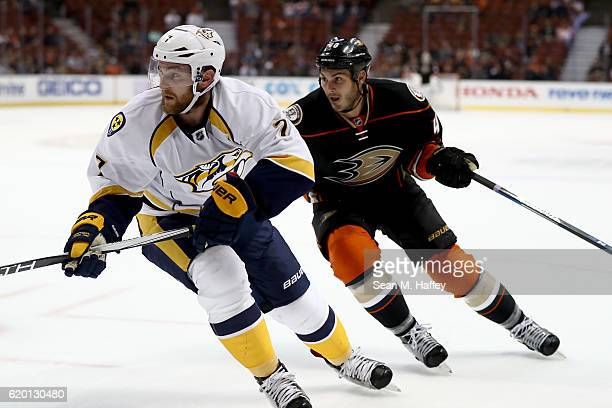 Jared Boll of the Anaheim Ducks and Yannick Weber of the Nashville Predators skate during the third period of a game at Honda Center on October 26...