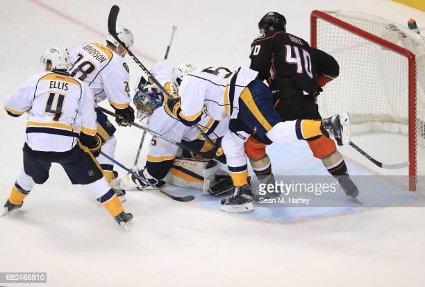 Jared Boll of the Anaheim Ducks fights for the rebound with Roman Josi Viktor Arvidsson and Ryan Ellis of the Nashville Predators as goaltender Pekka...