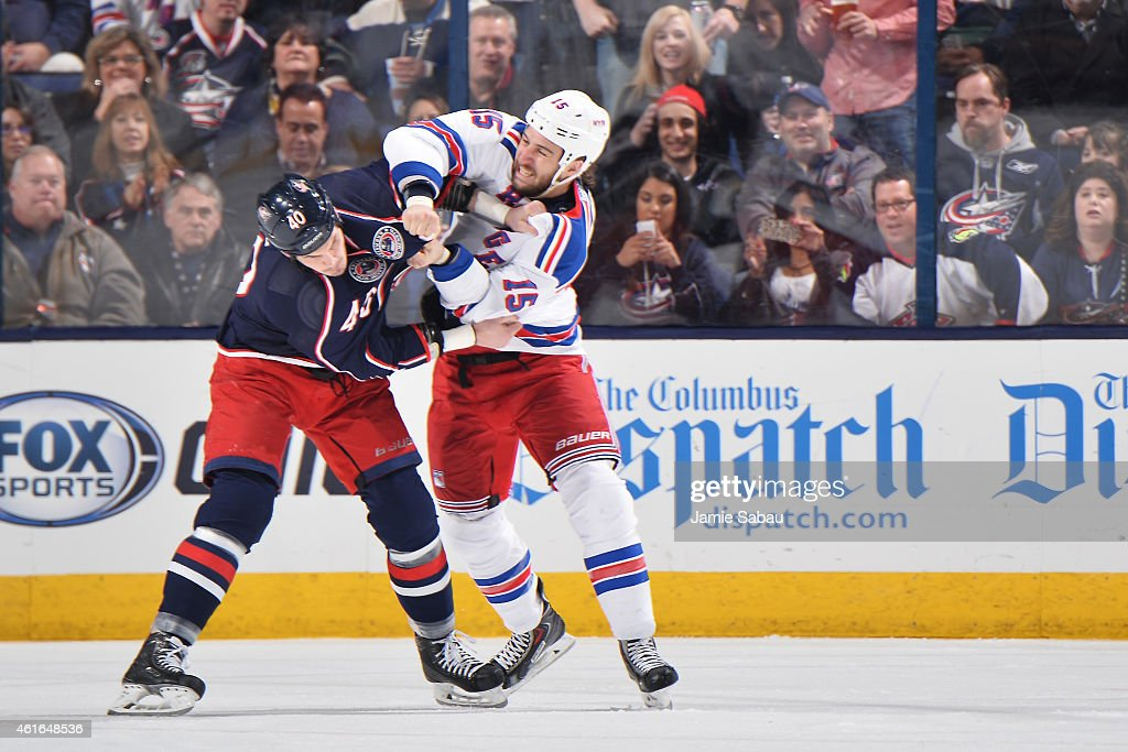 Jared Boll of the Columbus Blue Jackets and Tanner Glass of the New York Rangers fight during the second period of a game on January 16 2015 at...