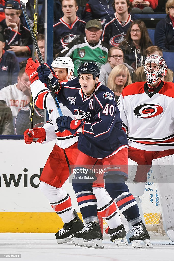 Jared Boll of the Columbus Blue Jackets battles for position with Tim Gleason of the Carolina Hurricanes on November 4 2014 at Nationwide Arena in...