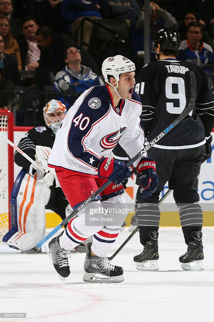 Jared Boll of the Columbus Blue Jackets celebrates David Savard's second period goal while John Tavares of the New York Islanders looks on during the...