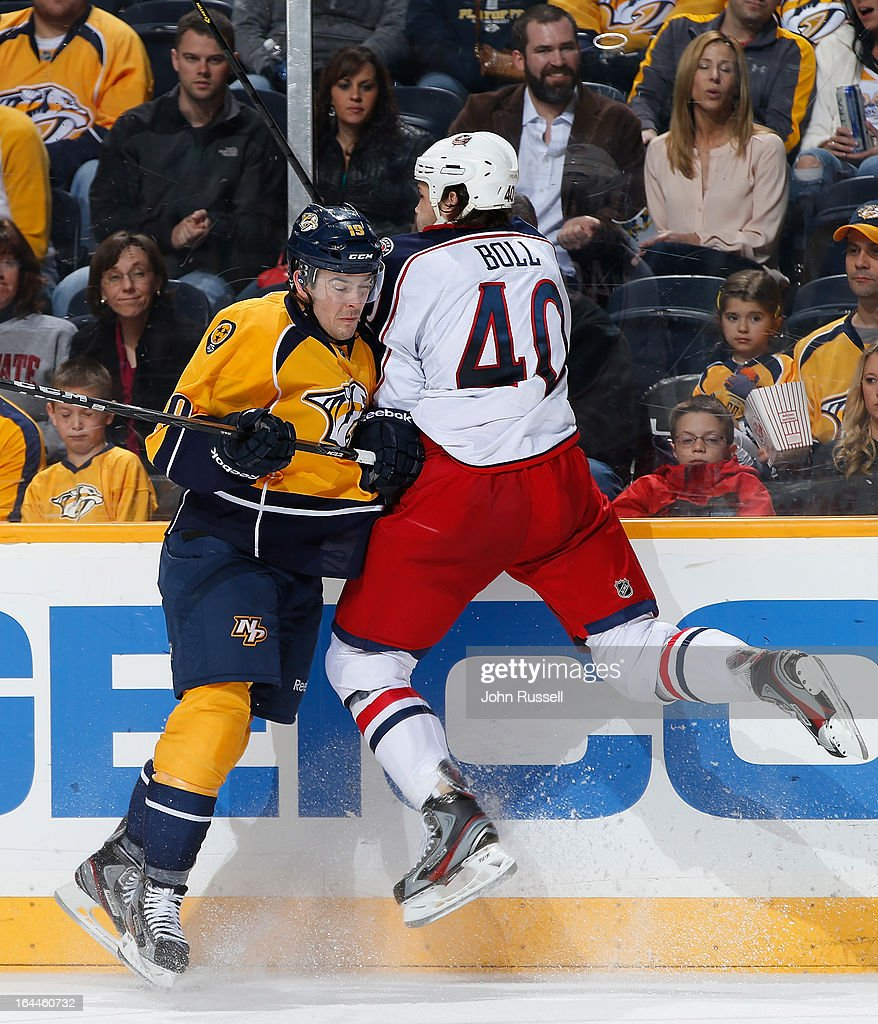 <a gi-track='captionPersonalityLinkClicked' href=/galleries/search?phrase=Jared+Boll&family=editorial&specificpeople=2238879 ng-click='$event.stopPropagation()'>Jared Boll</a> #40 of the Columbus Blue Jackets checks Bobby Butler #19 of the Nashville Predators during an NHL game at the Bridgestone Arena on March 23, 2013 in Nashville, Tennessee.