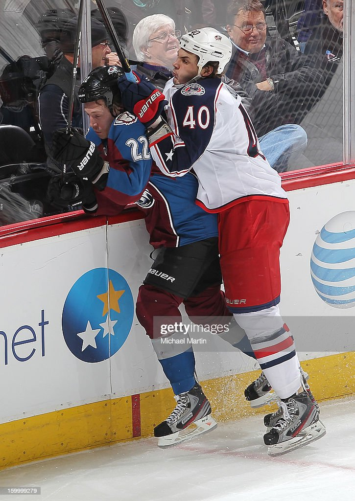 <a gi-track='captionPersonalityLinkClicked' href=/galleries/search?phrase=Jared+Boll&family=editorial&specificpeople=2238879 ng-click='$event.stopPropagation()'>Jared Boll</a> #40 of the Columbus Blue Jackets checks <a gi-track='captionPersonalityLinkClicked' href=/galleries/search?phrase=Matt+Hunwick&family=editorial&specificpeople=2284766 ng-click='$event.stopPropagation()'>Matt Hunwick</a> #22 of the Colorado Avalanche into the boards at the Pepsi Center on January 24, 2013 in Denver, Colorado.