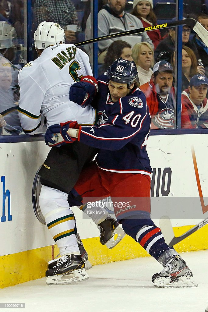 <a gi-track='captionPersonalityLinkClicked' href=/galleries/search?phrase=Jared+Boll&family=editorial&specificpeople=2238879 ng-click='$event.stopPropagation()'>Jared Boll</a> #40 of the Columbus Blue Jackets checks <a gi-track='captionPersonalityLinkClicked' href=/galleries/search?phrase=Trevor+Daley&family=editorial&specificpeople=213975 ng-click='$event.stopPropagation()'>Trevor Daley</a> #6 of the Dallas Stars during the second period on January 28, 2013 at Nationwide Arena in Columbus, Ohio.