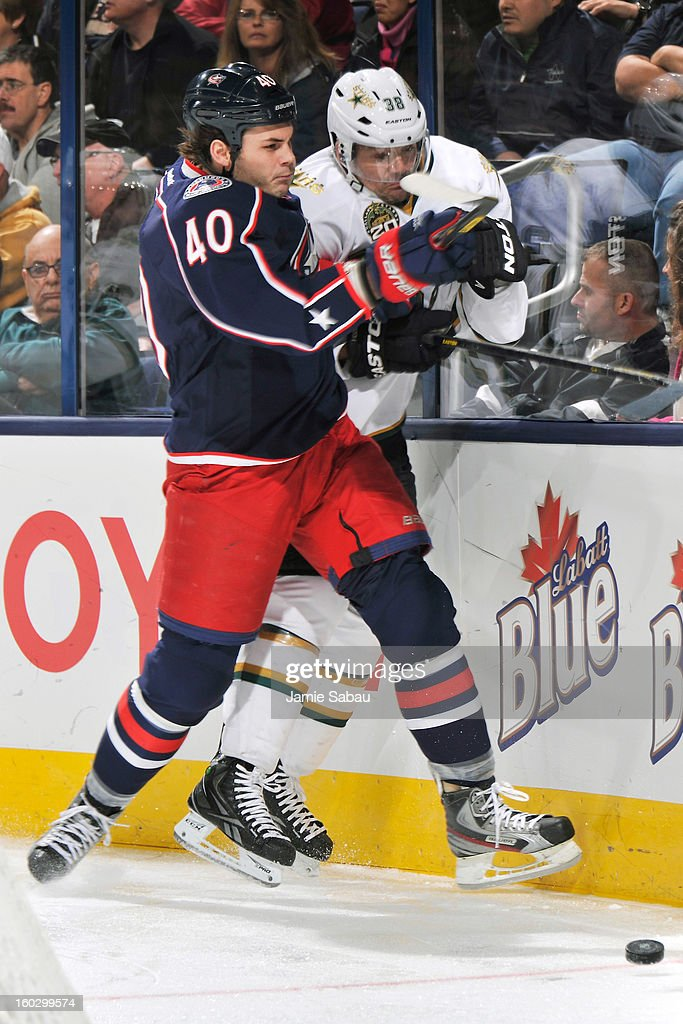<a gi-track='captionPersonalityLinkClicked' href=/galleries/search?phrase=Jared+Boll&family=editorial&specificpeople=2238879 ng-click='$event.stopPropagation()'>Jared Boll</a> #40 of the Columbus Blue Jackets checks <a gi-track='captionPersonalityLinkClicked' href=/galleries/search?phrase=Vernon+Fiddler&family=editorial&specificpeople=208086 ng-click='$event.stopPropagation()'>Vernon Fiddler</a> #38 of the Dallas Stars into the boards in the third period on January 28, 2013 at Nationwide Arena in Columbus, Ohio. Columbus defeated Dallas 2-1.