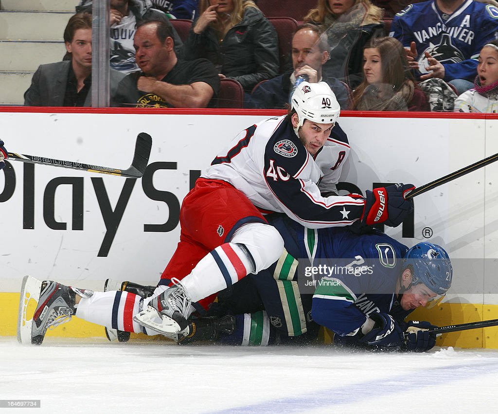 <a gi-track='captionPersonalityLinkClicked' href=/galleries/search?phrase=Jared+Boll&family=editorial&specificpeople=2238879 ng-click='$event.stopPropagation()'>Jared Boll</a> #40 of the Columbus Blue Jackets falls on <a gi-track='captionPersonalityLinkClicked' href=/galleries/search?phrase=Mason+Raymond&family=editorial&specificpeople=4521385 ng-click='$event.stopPropagation()'>Mason Raymond</a> #21 of the Vancouver Canucks during their NHL game at Rogers Arena March 26, 2013 in Vancouver, British Columbia, Canada. Vancouver won 1-0.