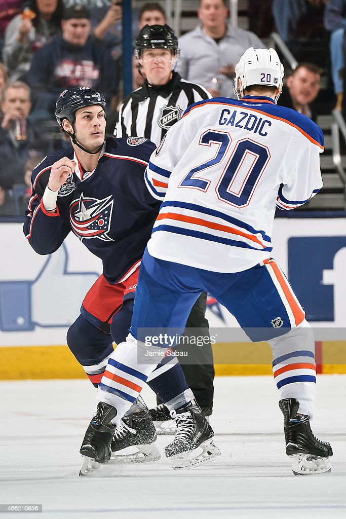Jared Boll of the Columbus Blue Jackets fights Luke Gazdic of the Edmonton Oilers on March 13 2015 at Nationwide Arena in Columbus Ohio